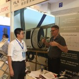 Nic discussing our SmartDiver technology with a visitor at Paste 2017 in China